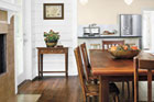 dining room with oak strip flooring in dark stain finish, all about prefinished wood foors