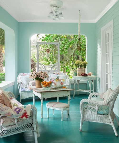 upgrade outdoor room, porch with blue-green painted floors and walls, white ceiling, wicker and vintage-look furniture