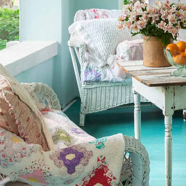 upgrade outdoor room, porch with vintage-style wicker furniture and quilts