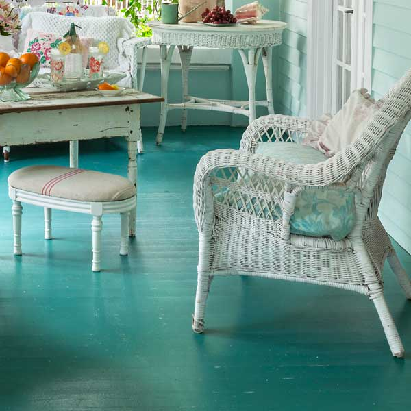 upgrade outdoor room, porch with vintage-style wicker furniture and burlap-sack cushioned foot stool
