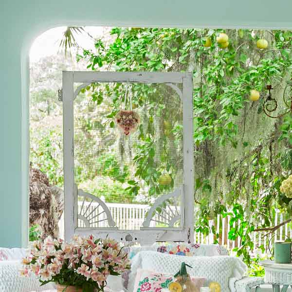 upgrade outdoor room, porch with vintage-style wicker furniture and salvaged screen door as decoration