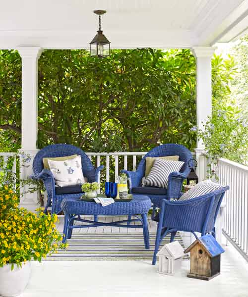 upgrade outdoor room, white porch with bright blue painted wicker furniture