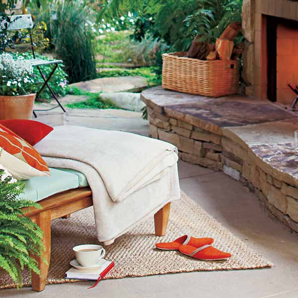 upgrade outdoor room, outdoor room with rug and basket on hearth