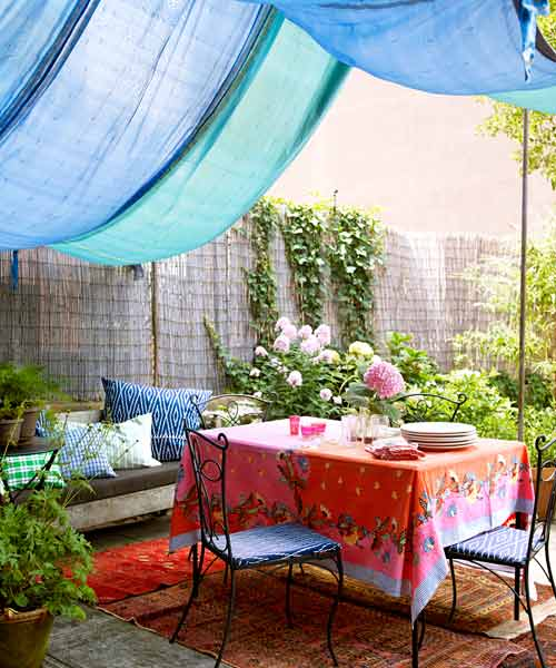 upgrade outdoor room, silk canopy over patio area with couch and dining set, potted plants