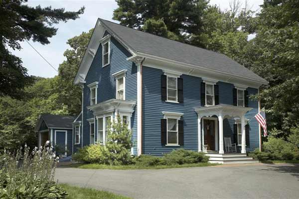 best exterior colors for colonial revival houses dusty blue house with darker blue shutters and white trim