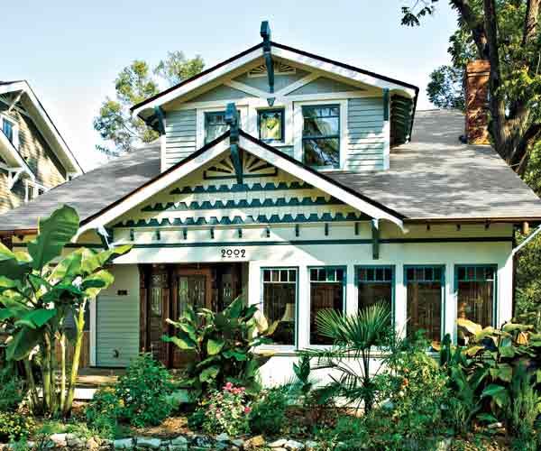 white and blue green exterior paint on craftsman style bungalow