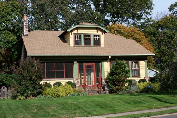 red and green accent exterior paint on craftsman style house