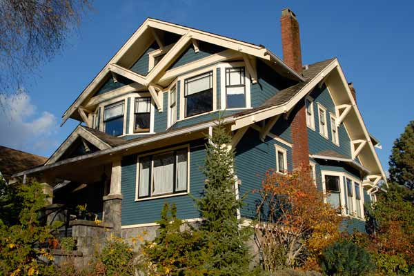green exterior paint with cream and green black accents on craftsman style house
