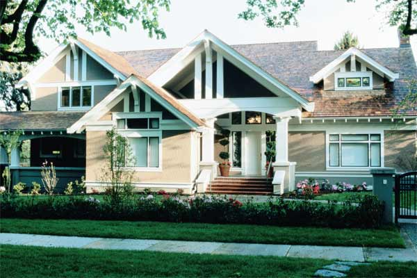 beige exterior paint with bright white accents, gray green foundation walls on craftsman style house