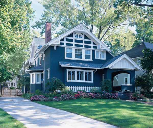 blue exterior paint with bright white accents on craftsman style house