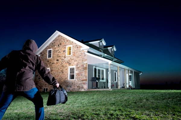 motion detector light in yard catching a potential burglar, homeowner survival skills