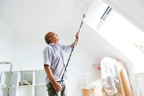 man painting bathroom ceiling, homeowner survival skills