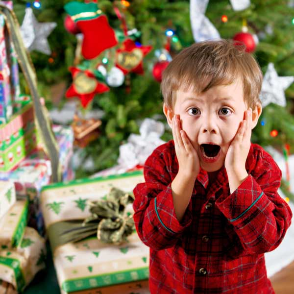 little boy screaming in front of a christmas tree, holiday disaster