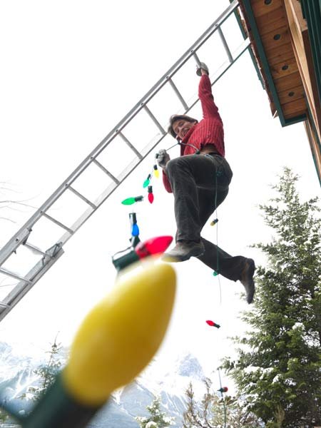 man falling off ladder while hanging christmas lights, holiday disaster