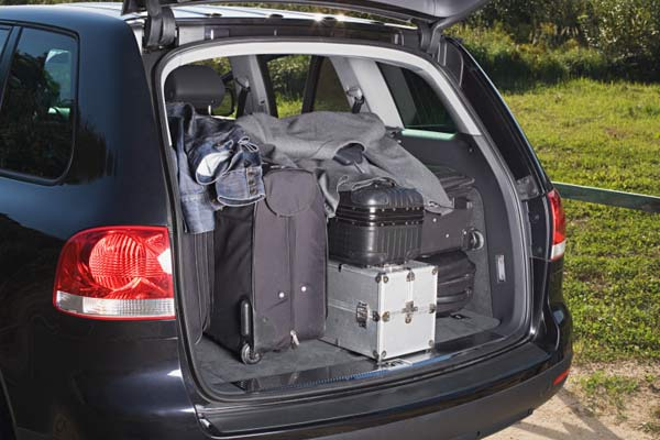 car trunk packed with luggage, holiday disaster