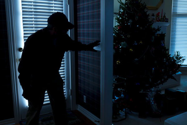 burglar breaking into home during Christmas holidays, home security tips for hoidays