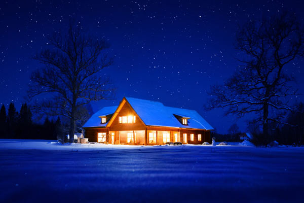 house lit up with lights at night, home security tips for hoidays