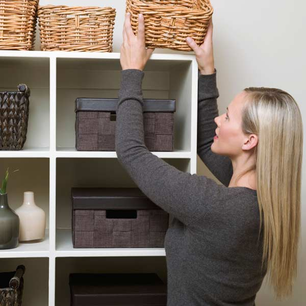 10 uses for weatherstripping women placing boxes on shelves