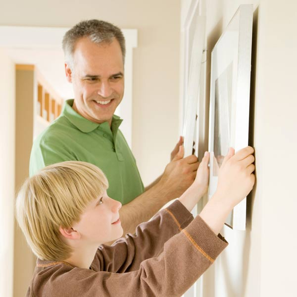 10 uses for weatherstripping young boy hanging wall art on wall