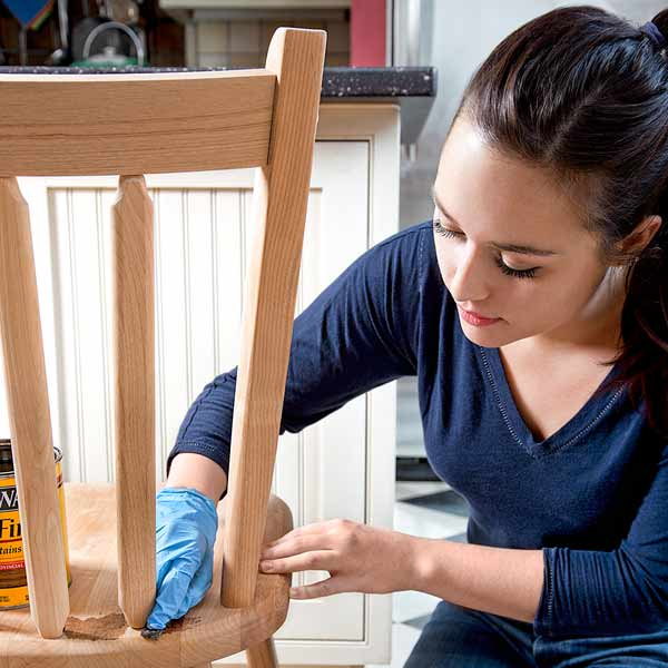 10 uses for weatherstripping spreading stain on chair with felt weather stripping squares