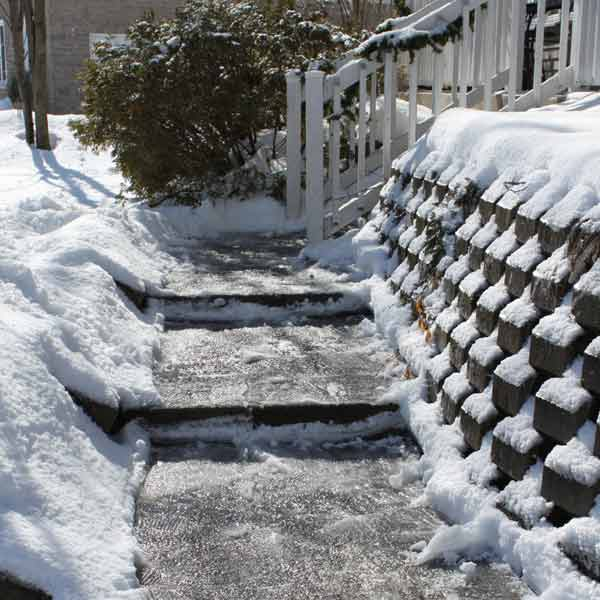 icy stairs leading up to house