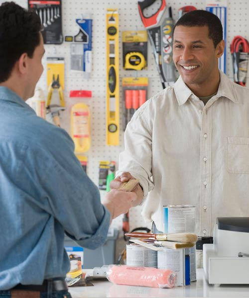 cashier helping customer at small hardware store