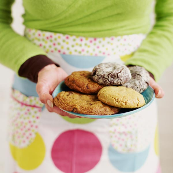 woman standing with plate of cookies