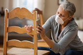 10 uses for sandpaper woman sanding paint off a wood chair