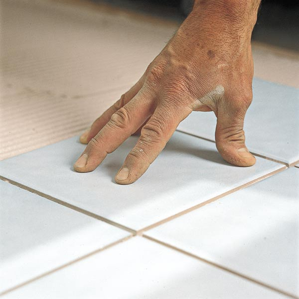 setting tile on thinset for floor