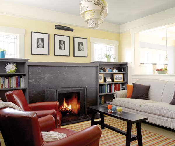 whole house remodel bungalow living room with schist fireplace surround