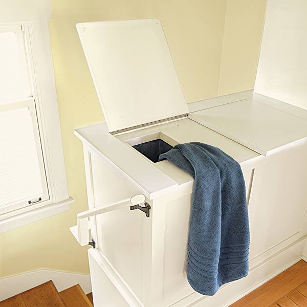 whole house remodel bungalow built-in storage cabinet with laundry shoot