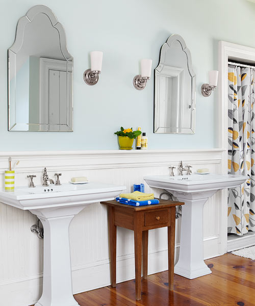 whole house before and after farmhouse master bath with two vanities, mirrors, freestanding table and new pine floors