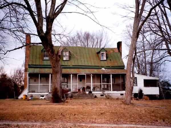 before farmhouse with metal roof whole house remodel
