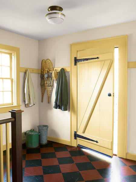 mudroom with barn-style door and painted checked floor, whole house remodel farmhouse addition