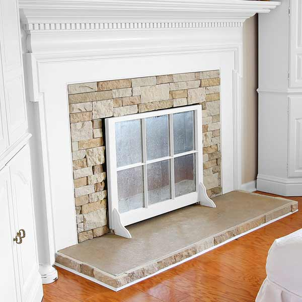 money saving blogger DIY project fireplace screen out of old window sash