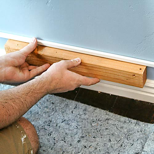 money saving blogger DIY project beefed up baseboards with bead trim step 1