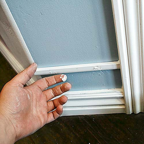 money saving blogger DIY project beefed up baseboards with bead trim step 2