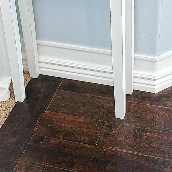money saving blogger DIY project beefed up baseboards with bead trim step 3