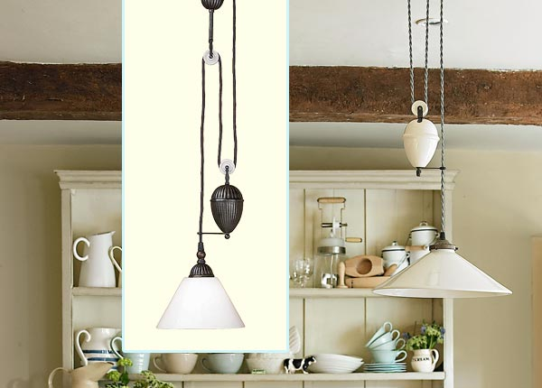 a breakfast nook decorated in a farmhouse style with inset of pendant light