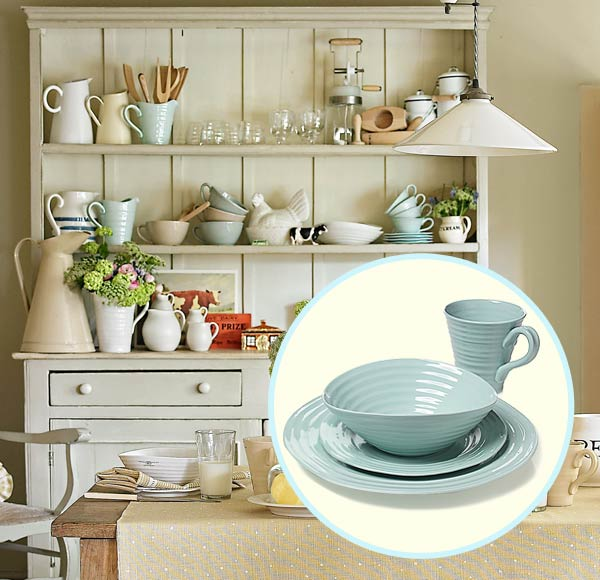 a breakfast nook decorated in a farmhouse style with inset of robin's-egg-blue porcelain dishware