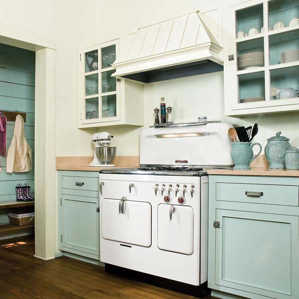 vintage style kitchen with painted kitchen cabinets