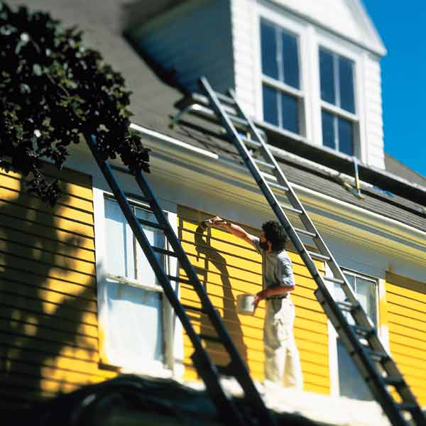 painting exterior of house yellow