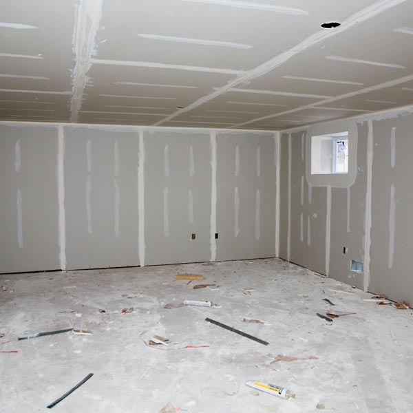 basement with unpainted and unsealed concrete floor