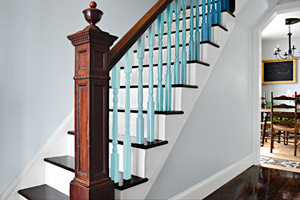 foyer with maple floors, stairs with painted blue ombre stair baulsters