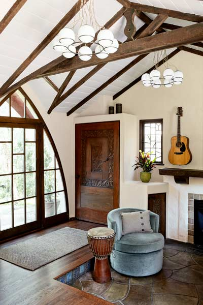 after remodel women's den with exposed ceiling beams and trusses