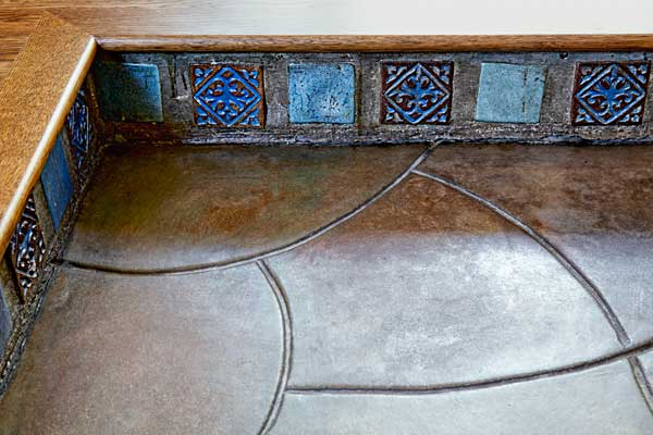 after remodel women's den with original molded concrete floor and decorative tile toekick