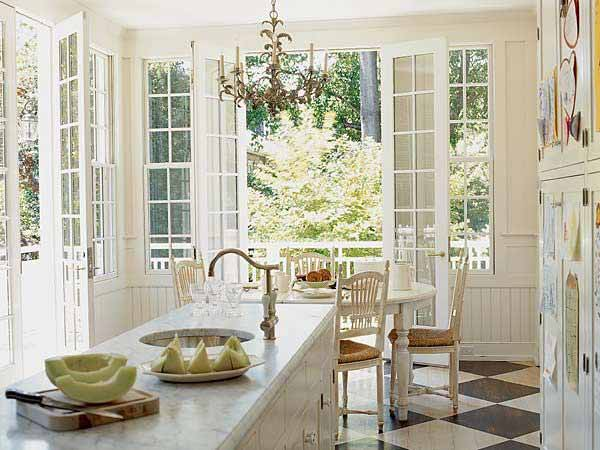 white kitchen with a chandelier and French doors, top pins on This Old House Pinterest profile 2013