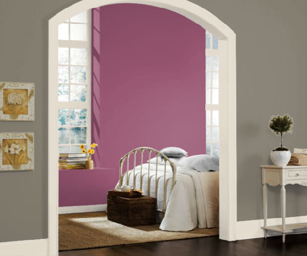 bedroom with Sherwin-Williams 6565 Grandeur Plum purple paint on walls, Pantone color of the year 2014 radiant orchid