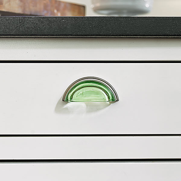 small open kitchen after remodel with green glass drawer bin pulls