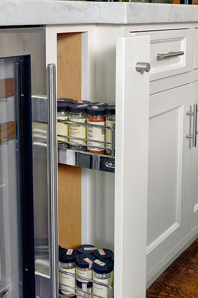 open kitchen remodel after with built-in drawer for pull-out spice rack